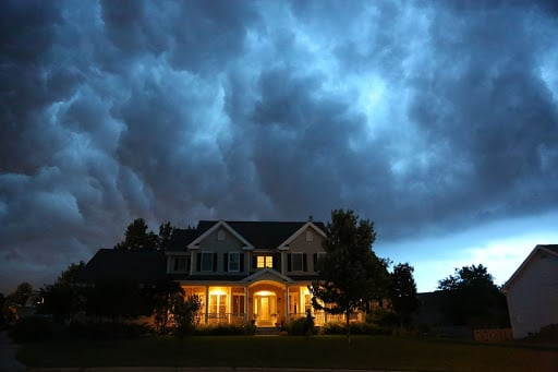 house with storm clouds overhead
